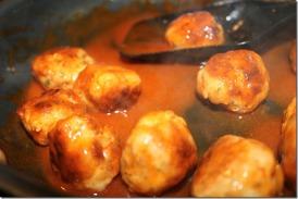 Add meatballs back into sauce...